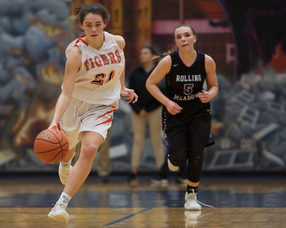 Wheaton Warrenville South's Kaitlyn Johnston leads the break away against Rolling Meadows on Feb 20 at the Class 4A sectional semifinal in Roselle.