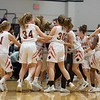 Wheaton Warrenville South celebrates the Win over Rolling Meadows on Feb 20 at the Class 4A sectional semifinal in Roselle.