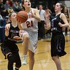 Wheaton Warrenville South's MacKenzie Stebbins splits Rolling Meadows defense to the basket on Feb 20 at the Class 4A sectional semifinal in Roselle.