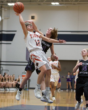 Wheaton Warrenville South's Mira Emma puts the shot up and fouled by Rollling Meadows Melissa Spiwak on Feb 20 at the Class 4A sectional semifinal in Roselle.