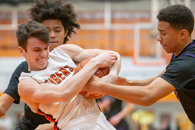 Crystal Lake Central's Blake Pokora wrestles for possession against Hampshire's Aj Bishop Friday, February 1, 2019 in Crystal Lake. Hampshire went on to get the conference win 71-56. KKoontz – For Shaw Media