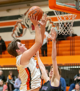 Crystal Lake Central's Alex Timmerman goes up for the basket over Hampshire's Nick Erickson Friday, February 1, 2019 in Crystal Lake. Hampshire went on to get the conference victory 71-56 with Timmerman finishing with 28 points. KKoontz- For Shaw Media