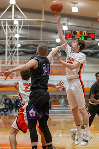 Crystal Lake Central's Christian Lerum takes a shot over Hampshire's Justin Anderson Friday, February 1, 2019 in Crystal Lake. Hampshire went on to get the conference victory 71-56. KKoontz- For Shaw Media