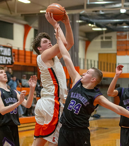 Crystal Lake Central's Alex Timmerman goes up for the shot over Hampshire's Justin Anderson Friday, February 1, 2019 in Crystal Lake. Hampshire went on to get the conference victory 71-56 with Timmerman finishing with 28 points. KKoontz- For Shaw Media