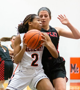 McHenry's Isabel Gscheidle drives along the baseline against Huntley's Melissa Moffet Monday, February 4, 2019 in McHenry. McHenry picked up their 20th win of the season downing Huntley 36-25.  KKoontz-For Shaw Media