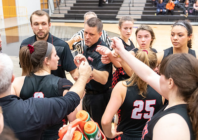 Huntley girls' basketball Head Coach, Steve Raethz, talks to his team during a timeout in the fourth quarter against McHenry Monday, February 4, 2019 in McHenry. McHenry took the victory 36-25. KKoontz – For Shaw Media
