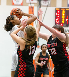 McHenry's Isabel Gscheidle fights for the shot against Huntley's Ashley Guazzo (Left) and Bridget Bigden Monday, February 4, 2019 in McHenry. McHenry picked up their 20th win of the season downing Huntley 36-25.  KKoontz-For Shaw Media