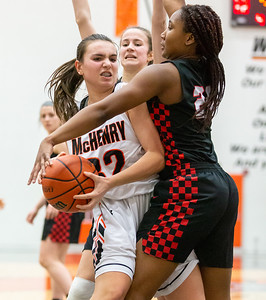 McHenry's Katie Beyer fights for position against Huntley's Kamsi Nwogu Monday, February 4, 2019 in McHenry. McHenry went on to win the game 36-25. KKoontz – For Shaw Media