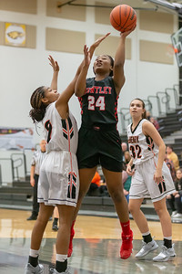 Huntley's Kamsi Nwogu goes up for the shot over McHenry's Isabel Gscheidle Monday, February 4, 2019 in McHenry. McHenry went on to win the game 36-25. KKoontz – For Shaw Media