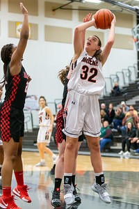 McHenry's Katie Beyer goes up for a shot under the rim over Huntley's Kamsi Nwogu Monday, February 4, 2019 in McHenry. McHenry went on to win the game 36-25. KKoontz – For Shaw Media