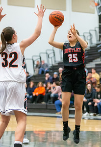 Huntley's Anna Seng goes up for a shot over McHenry's Katie Beyer Monday, February 4, 2019 in McHenry. Seng led Huntley in scoring with 8 points in the 36-25 loss to McHenry. KKoontz – For Shaw Media