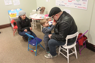 """Candace H. Johnson-For Shaw Media Katherine and Kevin O'Rourke, of Grayslake and their son, Oliver, 2, have some fun in the kids hands-on area during the opening day of the """"Where the Fun Grows: 60 Years of the Grayslake Community Park District"""" exhibit at the Grayslake Heritage Center & Museum. (2/2/19)"""