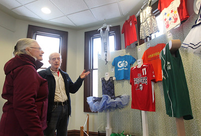 "Candace H. Johnson-For Shaw Media Joyce and Terry Norton, of Grayslake looks at the ""What's in Your Closet"" display featuring uniforms from different sports programs during the opening day of the ""Where the Fun Grows: 60 Years of the Grayslake Community Park District"" exhibit at the Grayslake Heritage Center & Museum. The exhibit is on display until November 2019. (2/2/19)"