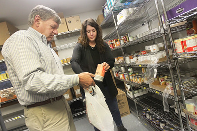 Candace H. Johnson-For Shaw Media Dan Venturi, supervisor and Jen Fielder, of Antioch, administrative assistant, bag a food order for a family at the Lake Villa Township Food Pantry in the township offices on Fairfield Road in Lake Villa. (2/5/19)