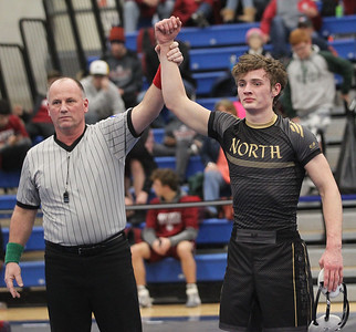 Candace H. Johnson-For Shaw Media Referee Mike Hurckes declares Grayslake North's Adam Blonski, Jr., the winner after he beat Grayslake Central's Joey Jens in the 152 lb. weight class to come in first place during the Class 2A Individual Regional Finals at Lakes Community High School in Lake Villa. (2/2/19)