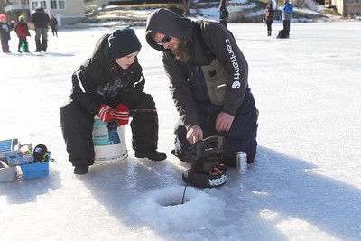 Candace H. Johnson-For Shaw Media Brodie Tillert, 8, of Ingleside learns how to ice fish from Jeff Schultz, of Hebron during the 59th Annual Chain O' Lakes Ice Fishing Derby and Winter Festival at Turtle Beach on Channel Lake in Antioch. The event was sponsored by the Northern Illinois Conservation Club. Brodie was at the event with his mother, Sandy, and it was his first time ice fishing.(2/9/19)