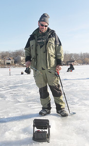 Candace H. Johnson-For Shaw Media Bob Risher, of Waukegan waits patiently to catch a big fish during the Chain O' Lakes Ice Fishing Derby and Winter Festival at Turtle Beach on Channel Lake in Antioch. The event was sponsored by the Northern Illinois Conservation Club. (2/9/19)