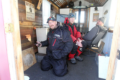 "Candace H. Johnson-For Shaw Media Tom Kiesgen, of Antioch and Mike Spachman, of Winthrop Harbor sit with Jim Boring, of Antioch in his ice shanty called, ""Shanty Town,"" while ice fishing during the 59th Annual Chain O' Lakes Ice Fishing Derby and Winter Festival at Turtle Beach on Channel Lake in Antioch. The event was sponsored by the Northern Illinois Conservation Club. (2/9/19)"