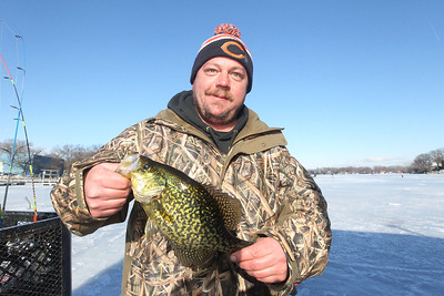 Candace H. Johnson-For Shaw Media Kevin Jewell, of McHenry shows off the thirteen-inch crappie he caught during the 59th Annual Chain O' Lakes Ice Fishing Derby and Winter Festival at Turtle Beach on Channel Lake in Antioch. The event was sponsored by the Northern Illinois Conservation Club. (2/9/19)