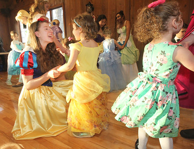Candace H. Johnson-For Shaw Media Elizabeth Payson, 15, of Lake Villa (Snow White) dances with Hannah Sackman, 4, of Wadsworth during a magical Enchanted Evening at the Viking Park Dance Hall in Gurnee. The event was sponsored by the Gurnee Park District. (2/9/19)