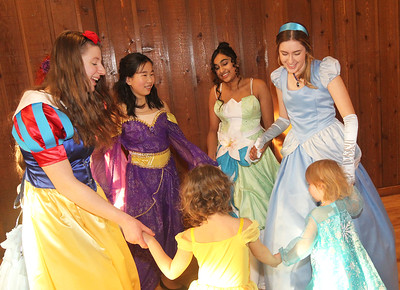 Candace H. Johnson-For Shaw Media Little girls dance with their favorite princesses during a magical Enchanted Evening at the Viking Park Dance Hall in Gurnee. The event was sponsored by the Gurnee Park District. The music was provided by Memory Makers Entertainment. (2/9/19)