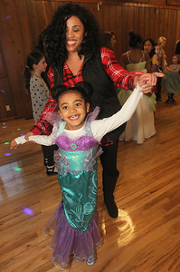 "Candace H. Johnson-For Shaw Media Trese Esparza, of Round Lake and her daughter Azariah, 6, dance to a song called, ""Uptown Funk,"" during a magical Enchanted Evening at the Viking Park Dance Hall in Gurnee. The event was sponsored by the Gurnee Park District. (2/9/19)"