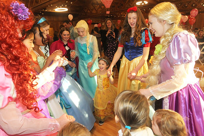 Candace H. Johnson-For Shaw Media Hannah Sackman, 4, of Wadsworth (center) dances with the princesses during a magical Enchanted Evening at the Viking Park Dance Hall in Gurnee. The event was sponsored by the Gurnee Park District. (2/9/19)