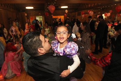 Candace H. Johnson-For Shaw Media Luis Esparza, of Round Lake and his daughter, Cambrya, 5, dance to the music during a magical Enchanted Evening at the Viking Park Dance Hall in Gurnee. The event was sponsored by the Gurnee Park District. The music was provided by Memory Makers Entertainment. (2/9/19)