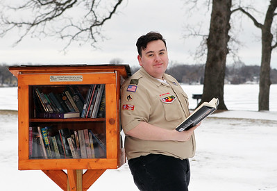 Candace H. Johnson-For Shaw Media Dante Rivera, 17, of Round Lake, with Boy Scout Troop 275, stands next to the Little Free Library he made for his Eagle Scout project at Lakefront Park in Round Lake Beach. Dante made a total of six Little Free Libraries, distributed throughout Round Lake Beach.(2/16/19)