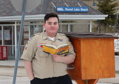 Candace H. Johnson-For Shaw Media Dante Rivera, 17, of Round Lake with Boy Scout Troop 275 stands next to the Little Free Library he created for his Eagle Scout project at the Round Lake Beach Metra train station. (2/16/19)