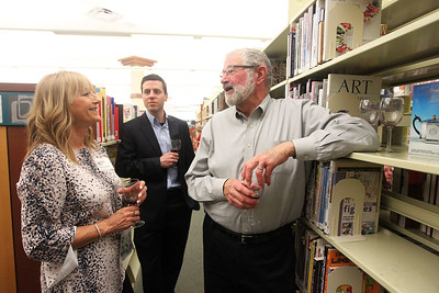 Candace H. Johnson-For Shaw Media Andy Lentine, of Lake Villa, library director, talks with Darren Scheretter, of Palatine and John Hamlin, of Lake Villa as they listen to John Primer and The Real Deal Blues Band during Grapes & Growlers-A Night at the Library at the Lake Villa District Library. Grapes & Growlers is the Lake Villa District Foundation's annual winter event with wine and craft beer tastings. (2/15/19)