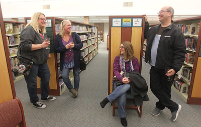 Candace H. Johnson-For Shaw Media Carrie Bishop and Chrissy Greenlee talk with Beth and Larry Padilla, all neighbors from Lake Villa, during Grapes & Growlers-A Night at the Library at the Lake Villa District Library. Grapes & Growlers is the Lake Villa District Foundation's annual winter event with wine and craft beer tastings. (2/15/19)