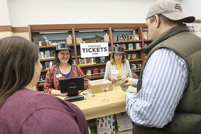 Candace H. Johnson-For Shaw Media Rachel Quan, of Round Lake Beach and Barb Venturi, of Lake Villa, sell raffle tickets to Kristin and Craig Jouppi, of Antioch during Grapes & Growlers-A Night at the Library at the Lake Villa District Library. Grapes & Growlers is the Lake Villa District Foundation's annual winter event with wine and craft beer tastings. (2/15/19)