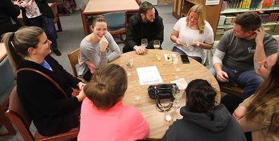 Candace H. Johnson-For Shaw Media A group of friends sit together during Grapes & Growlers-A Night at the Library at the Lake Villa District Library. Grapes & Growlers is the Lake Villa District Foundation's annual winter event with wine and craft beer tastings. (2/15/19)