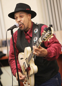 Candace H. Johnson-For Shaw Media John Primer, of Lindenhurst with the John Primer and The Real Deal Blues Band entertains the crowd as he sings the Blues during Grapes & Growlers-A Night at the Library at the Lake Villa District Library. Grapes & Growlers is the Lake Villa District Foundation's annual winter event with wine and craft beer tastings. (2/15/19)