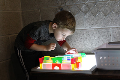 Candace H. Johnson-For Shaw Media Logan Wagner, 5, of Winthrop Harbor has fun playing at the light table in the Kohl Children's Museum pop-up museum at the Urban Edge storefront gallery on Clayton Street in downtown Waukegan. The pop-up museum will be open until March 23rd. (2/16/19)