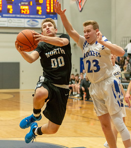 Woodstock North's Zach White drives the lane against Burlington Central's Braden Seyller Friday, February 22, 2019 in Burlington. Burlington Central went on to win the game 58-43 and win the Kishwaukee River Conference outright.  KKoontz – For Shaw Media