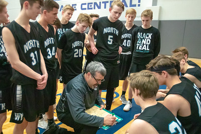 Woodstock North head basketball Coach Dale Jandron talks with his team during a timeout against Burlington Central Friday, February 22, 2019 in Burlington. Burlington Central went on to win the game 58-43 and win the Kishwaukee River Conference outright. KKoontz – For Shaw Media