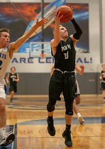 Woodstock North's Ryan Schaffter drives the lane against Burlington Central Friday, February 22, 2019 in Burlington. Burlington Central went on to win the game 58-43 and win the Kishwaukee River Conference outright.  KKoontz – For Shaw Media