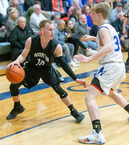 Woodstock North's Ryan Schaffter (Left) works against Burlington Central's Carson Seyller Friday, February 22, 2019 in Burlington. Burlington Central went on to win the game 58-43 and win the Kishwaukee River Conference outright.  KKoontz – For Shaw Media