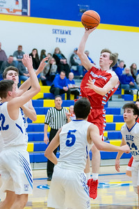 Marian Central Catholic's Benjamin Moscinski pulls up for the jump shot against Woodstock Monday, February 25, 2019 at Class 3A Boys Basketball Regional held at Johnsburg High School in Johnsburg. Marian went on to get their second win of the year beating Woodstock 75-68 and will face Johnsburg tomorrow night. KKoontz – For Shaw Media