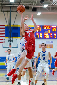 Marian Central Catholic's Benjamin Moscinski drives the lane and goes up for the shot against Woodstock Monday, February 25, 2019 at Class 3A Boys Basketball Regional held at Johnsburg High School in Johnsburg. Marian went on to get their second win of the year beating Woodstock 75-68 and will face Johnsburg tomorrow night. KKoontz – For Shaw Media