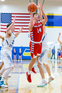 Marian Central Catholic's Austin Geils drives the lane for the shot against Woodstock Monday, February 25, 2019 at Class 3A Boys Basketball Regional held at Johnsburg High School in Johnsburg. Marian went on to get their second win of the year beating Woodstock 75-68 and will face Johnsburg tomorrow night. KKoontz – For Shaw Media
