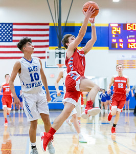 Marian Central Catholic's Jakub Baranski goes in for the lay-up against Woodstock Monday, February 25, 2019 at Class 3A Boys Basketball Regional held at Johnsburg High School in Johnsburg. Marian went on to get their second win of the year beating Woodstock 75-68 and will face Johnsburg tomorrow night. KKoontz – For Shaw Media