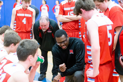 Marian Central Catholic's head basketball coach  Curtis Price talks with his team during a fourth quarter time-out Monday, February 25, 2019 at Class 3A Boys Basketball Regional held at Johnsburg High School in Johnsburg. Marian got their second win of the year beating Woodstock 75-68 and will face Johnsburg tomorrow night. KKoontz – For Shaw Media