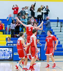 Marian Central Catholic players celebrate their win over Woodstock Monday, February 25, 2019 at Class 3A Boys Basketball Regional held at Johnsburg High School in Johnsburg. Marian got their second win of the year beating Woodstock 75-68 and will face Johnsburg tomorrow night. KKoontz – For Shaw Media