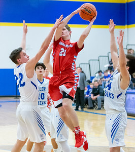 Marian Central Catholic's Ben Minneci goes up for the shot over Woodstock's Nicholas Weber Monday, February 25, 2019 at Class 3A Boys Basketball Regional held at Johnsburg High School in Johnsburg. Marian went on to get their second win of the year beating Woodstock 75-68 and will face Johnsburg tomorrow night. KKoontz – For Shaw Media