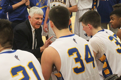 Candace H. Johnson-For Shaw Media Warren's Jon Jasnoch, head coach, talks with his boys varsity basketball team as they play Lakes in the Class 4A regional at Grayslake North High School. Warren won 51-35. (2/25/19)