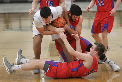 Candace H. Johnson-For Shaw Media Warren's Juan DelaCruz scrambles for a loose ball with Lakes Bradley Bies and Alec Meyer during the second quarter in the Class 4A regional at Grayslake North High School. Warren won 51-35. (2/25/19)