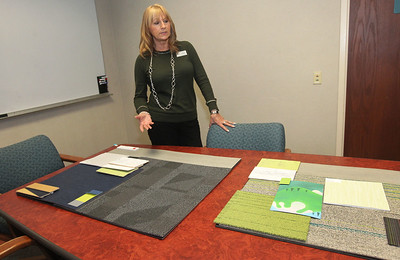 Candace H. Johnson-For Shaw Media Library Director Andy Lentine talks about the floor and wall coverings chosen for the new Lake Villa District Library on Munn Road in Lindenhurst at the current building in Lake Villa. (2/25/19)